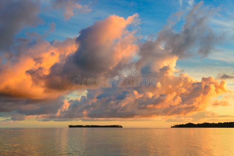 Sunriset dramatic sky on sea, tropical desert beach, no people, stormy clouds, travel destination, Indonesia Banyak Islands stock image