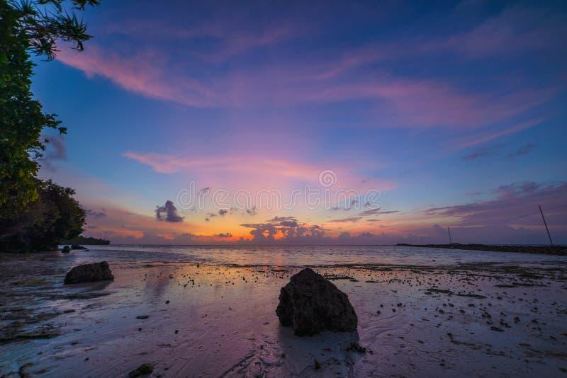 Sunriset dramatic sky on sea, tropical desert beach, no people, stormy clouds, travel destination, Indonesia Banyak Islands royalty free stock image