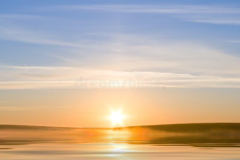 Sunrising on the sea stock images