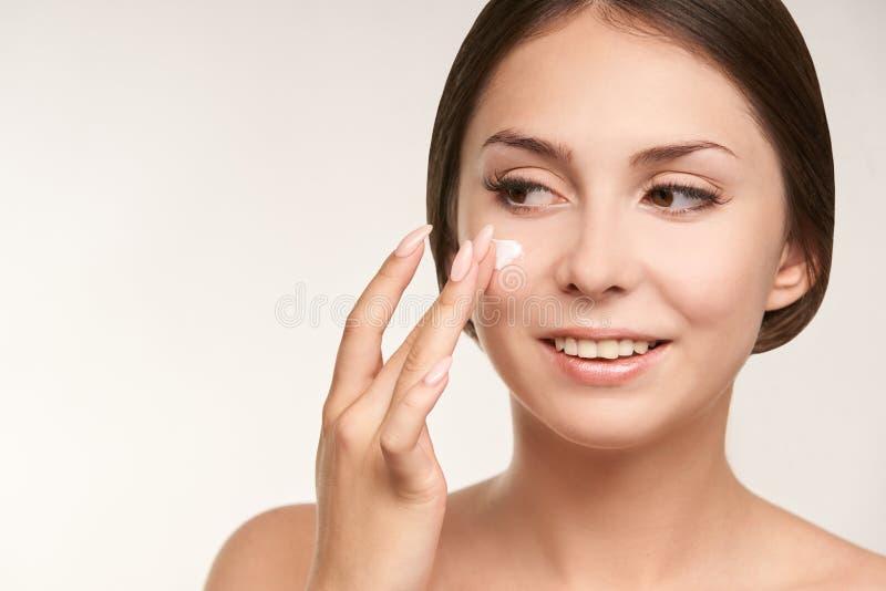 Sunscreen skin cream woman. Skincare tan girl. Cancer damage stock photography