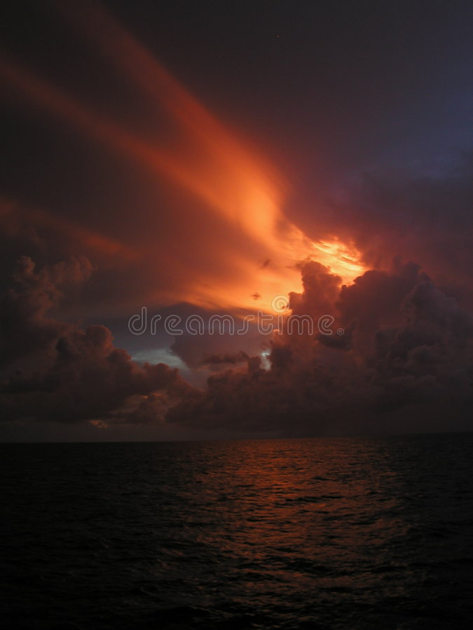 Download Sunset 1 stock photo. Image of sunset, water, sunray, formations - 1082008