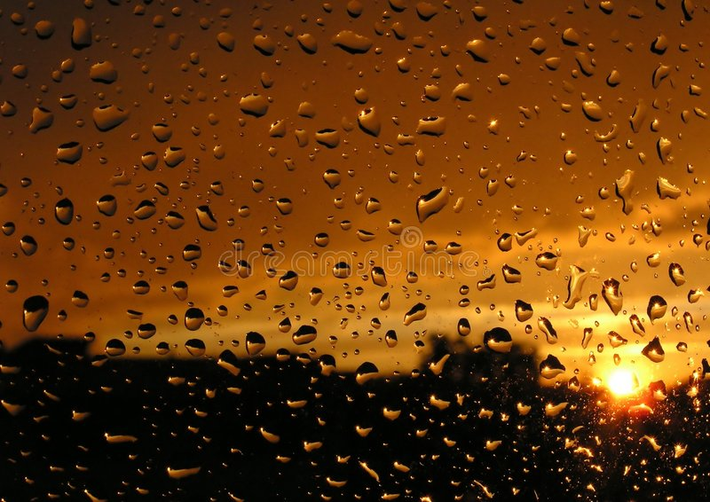 Sunset. Trough a wet window royalty free stock images