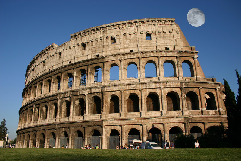 Before sunset. Colosseum and moon before sunset