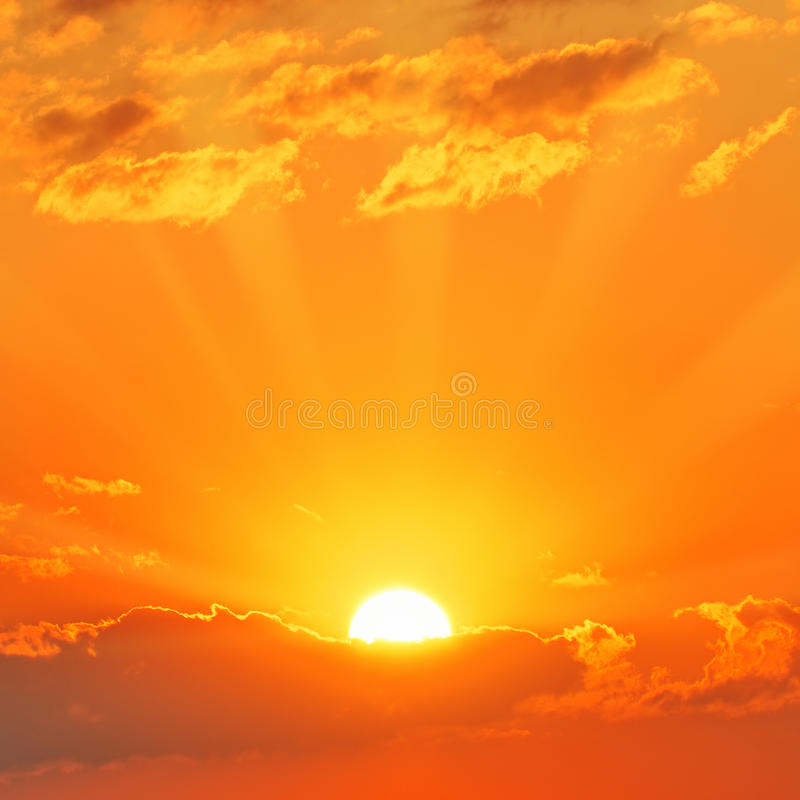 Sunset. The sun behind the clouds. Beautiful sunset stock photo