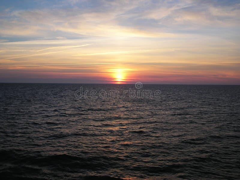 Sunset. Over the sea stock photos