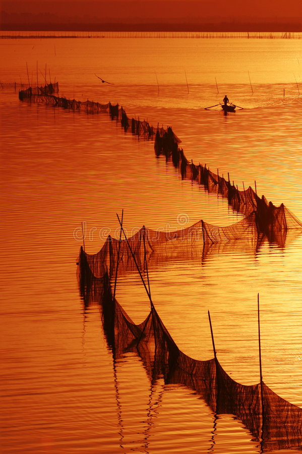 Sunset. A fishman is going home royalty free stock photo
