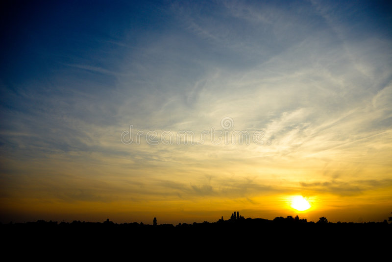 Sunset. A great atmosphere created by the sunset and the interesting clouds stock photo