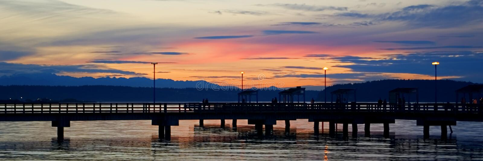 Sunset. Overlooking a fishing pier royalty free stock images