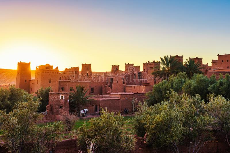 Sunset above ancient city of Ait Benhaddou in Morocco. This fortified city was built along the caravan route between Sahara and Marrakesh and is a popular stock image