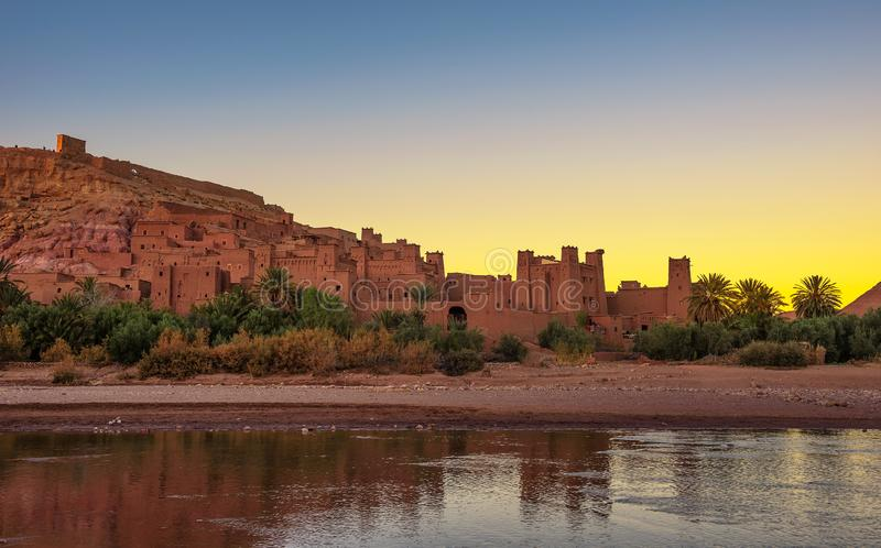 Sunset above ancient city of Ait Benhaddou in Morocco. This fortified city was built along the caravan route between Sahara and Marrakesh and is a popular stock photography