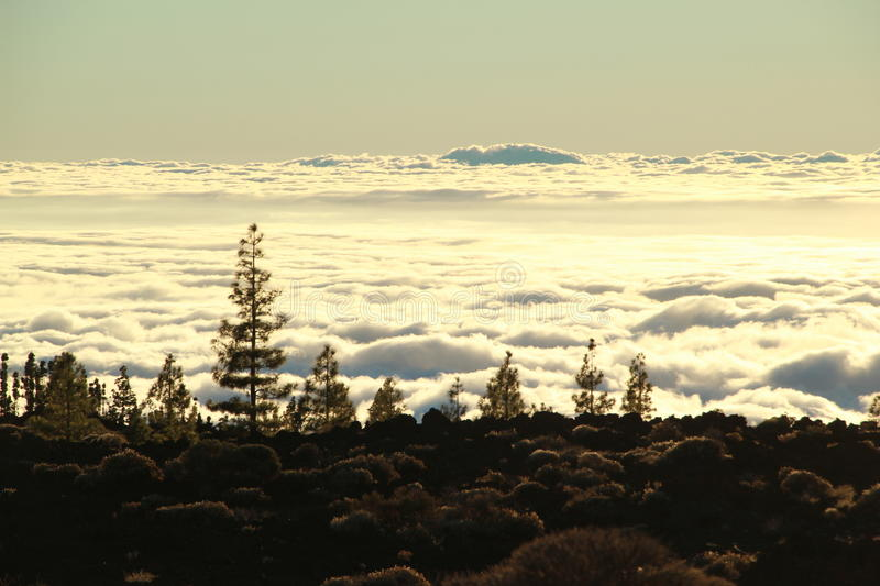 Sunset above the clouds in Tenerife. Driving down El Teide to see wonderful sunset above the clouds royalty free stock photos