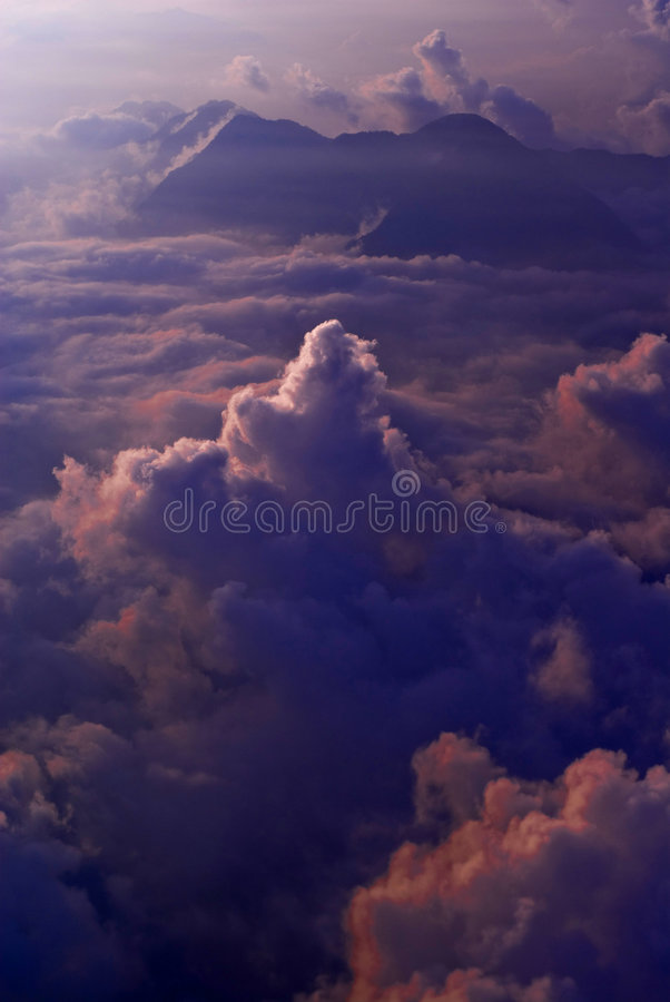 Sunset above the clouds stock images