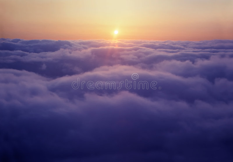 Sunset above the clouds royalty free stock images