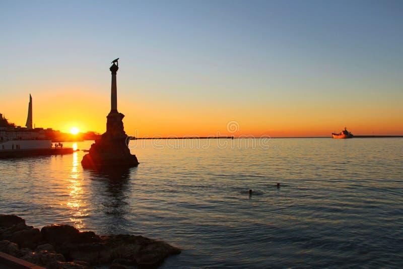 Sunset above embankment of Sevastopol stock photo