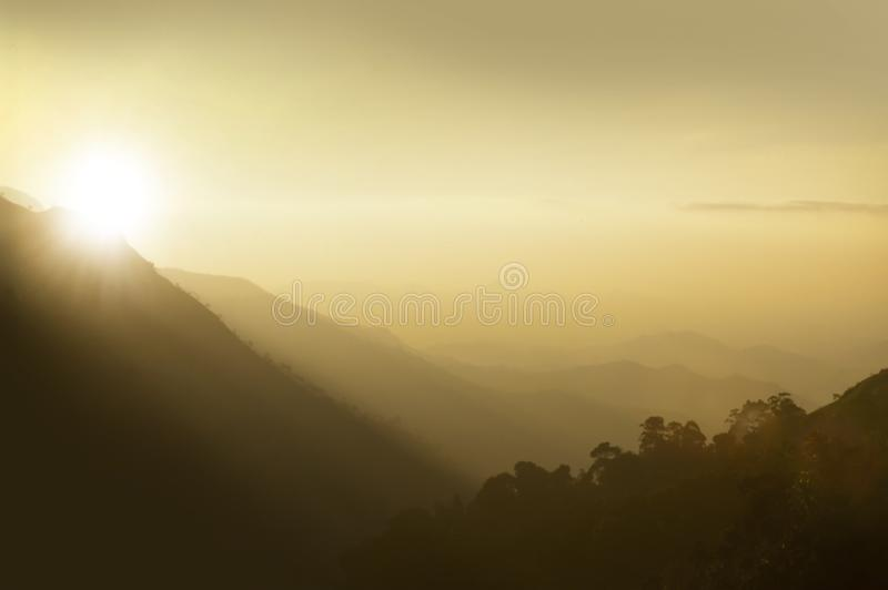 Sunset above hazy mountains royalty free stock photo