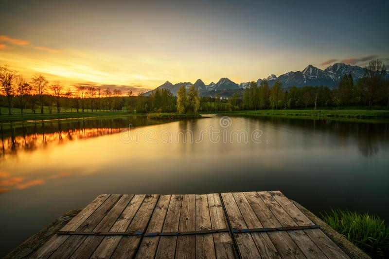 Sunset above a lake in high tatra mountains in Slovakia royalty free stock image