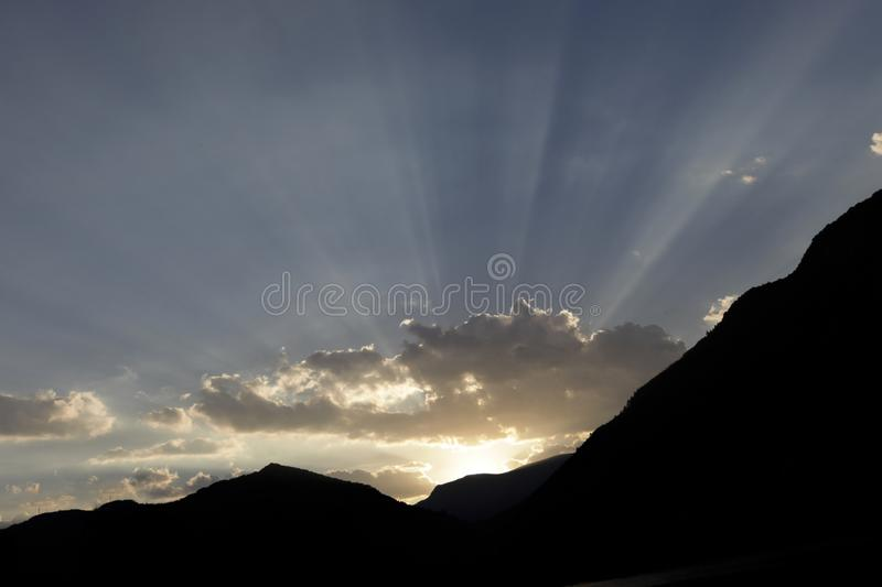 Sunset above a lake in south france, with amazing beautiful light rays royalty free stock photos