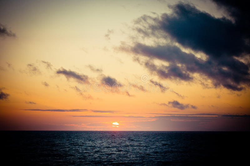 Sunset above the sea. Sea Rythm on sand with wave on sea coast at sunset stock images