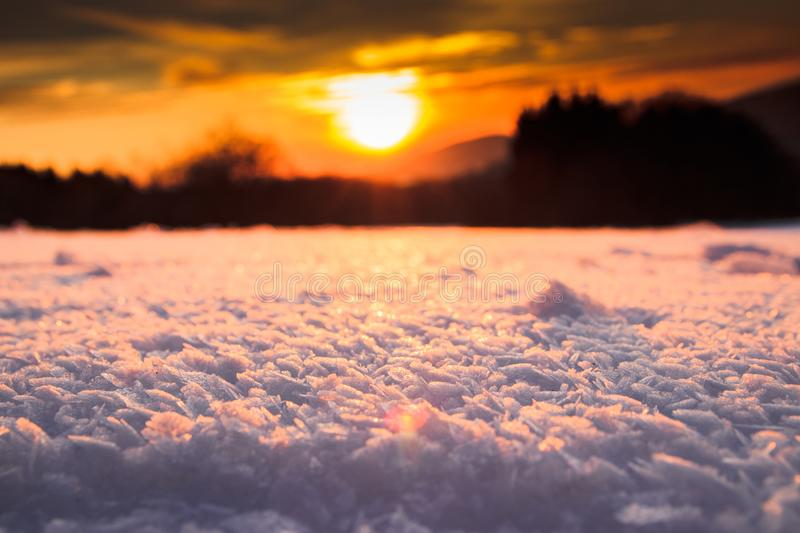 sunset above a snowy bottom royalty free stock image