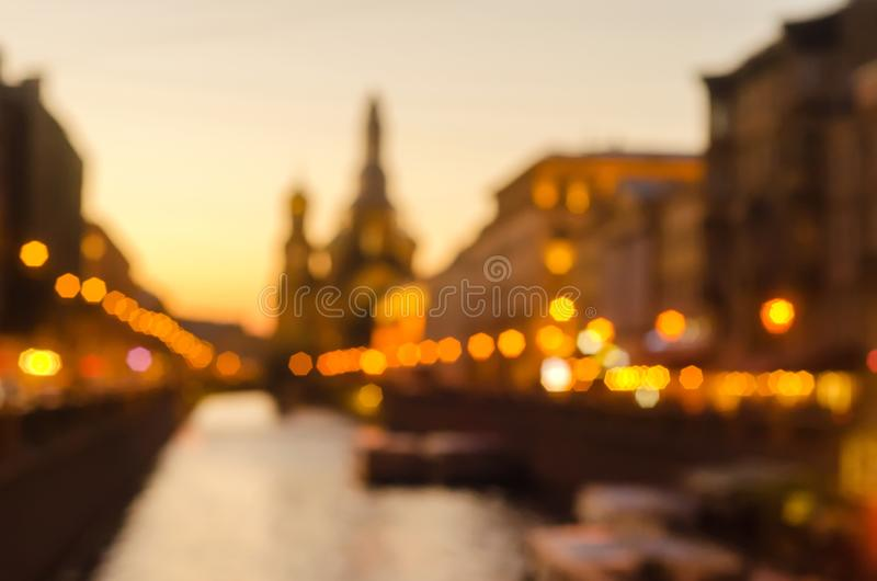 Sunset abstract blurred city view in St.Petersburg.Popular tourist place in the city.Summer white nights for tourist stock image