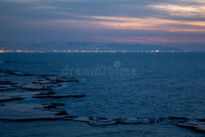 Sunset at acient Akko seashore stock images