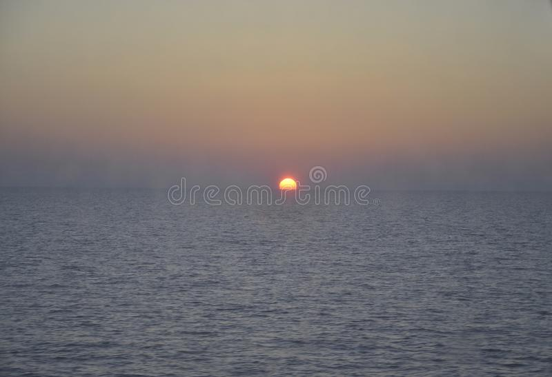 Sunset on Aegean Sea through the Ferryboat window royalty free stock images