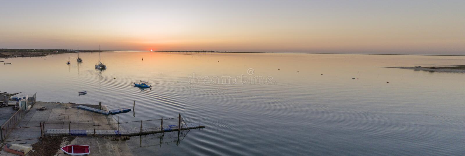 Sunset aerial panoramic seascape view of Olhao dockyard, waterfront to Ria Formosa natural park royalty free stock images