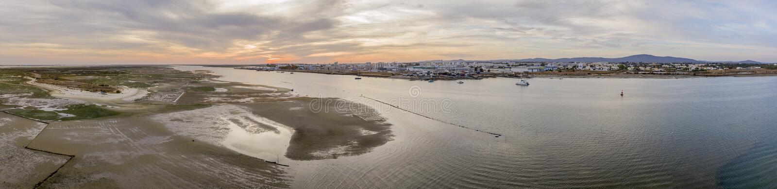 Sunset aerial panoramic seascape view of Olhao dockyard, waterfront to Ria Formosa natural park stock photography