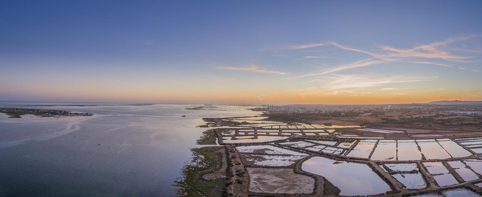 Sunset aerial panoramic view, in Ria Formosa wetlands natural park. Algarve. royalty free stock photo