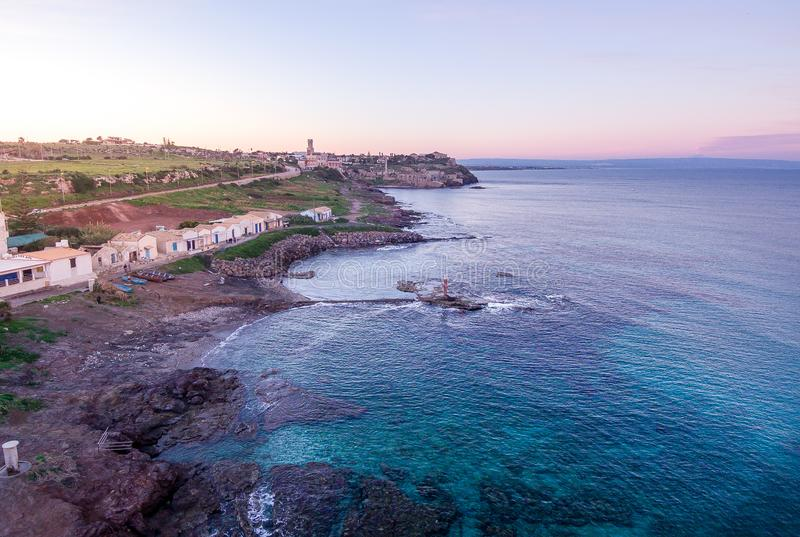 Sunset aerial view of the coastline of Portopalo and the Tafuri castle, Sicily, Italy stock image