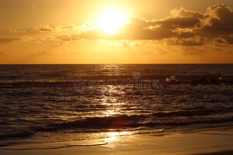 Sunset in the afternoon at the beach. This picture was Made yesterday afternoon. It was a cloudy bit also sunny day. The colors were so nice and beautiful at royalty free stock photos