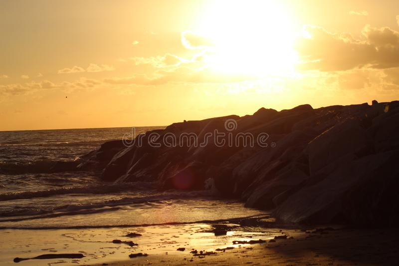 Sunset in the afternoon at the beach. This picture was Made yesterday afternoon. It was a cloudy bit also sunny day. The colors were so nice and beautiful at royalty free stock images