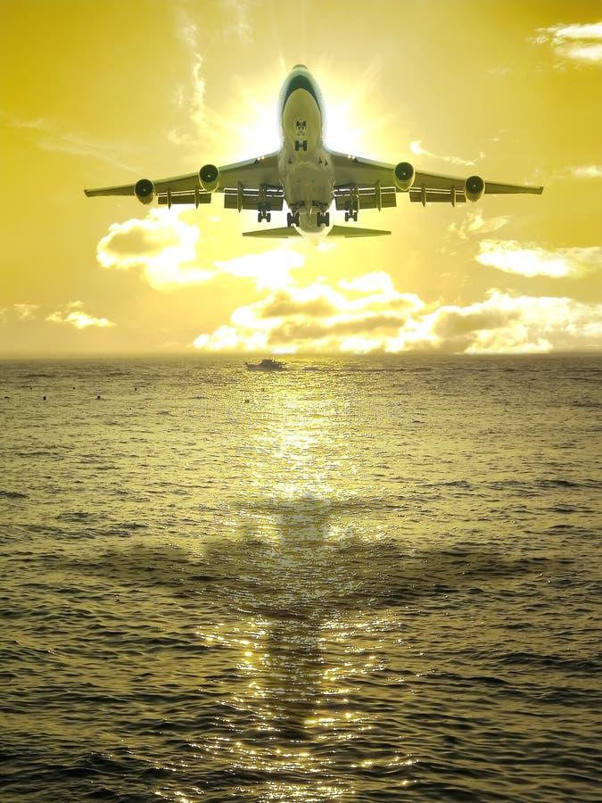 Sunset and airplane stock photo