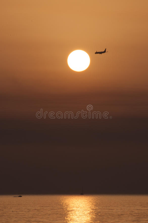 Sunset With Airplane Stock Photos