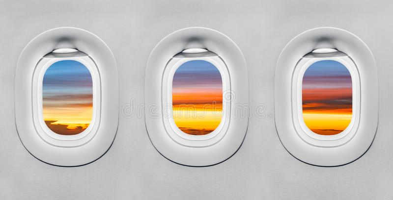 Sunset at airplane window royalty free stock images