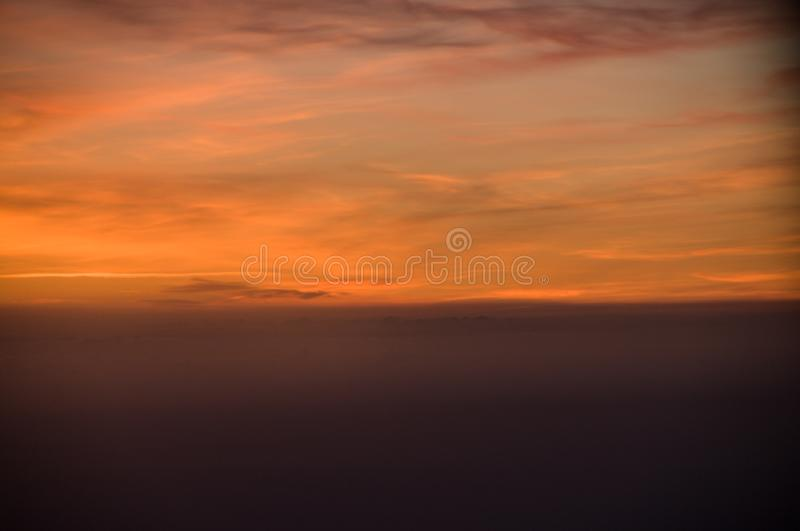 Sunset from the airplane window. Beautiful view. Sky. Red. Colorful stock photo