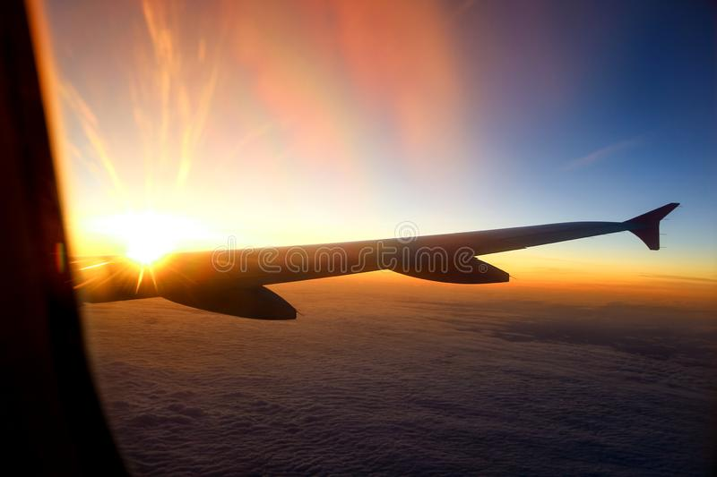 Sunset from the airplane window royalty free stock photography