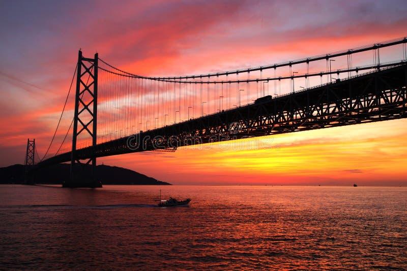 Sunset at Akashi Kaikyo Bridge royalty free stock photos