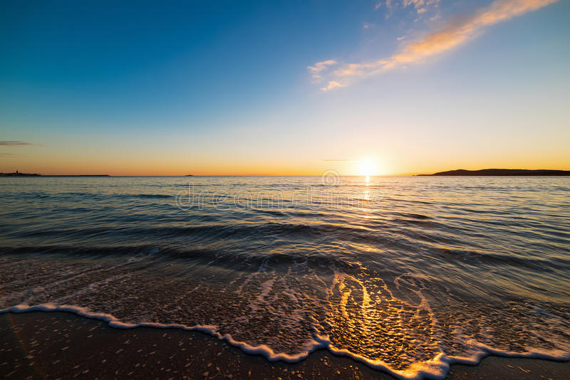 Sunset in Alghero. Small waves at sunset in Alghero, Sardinia stock photography