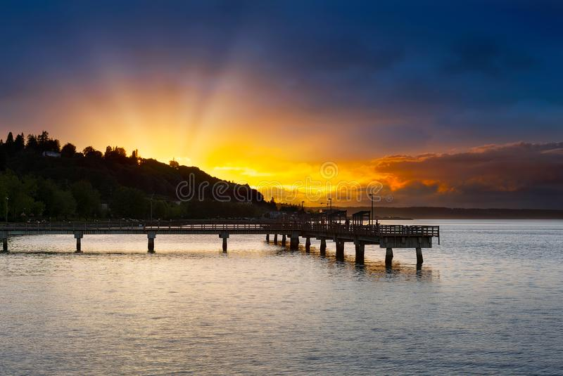 Sunset at Ruston Way Waterfront in Tacoma WA. Sunset along Ruston Way by fishing pier on Commencement Bayin Tacoma Washington royalty free stock photos