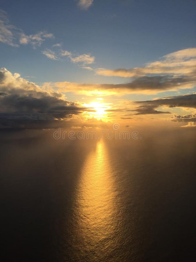 Sunset from 15000' altitude on the way to Kauai. stock image
