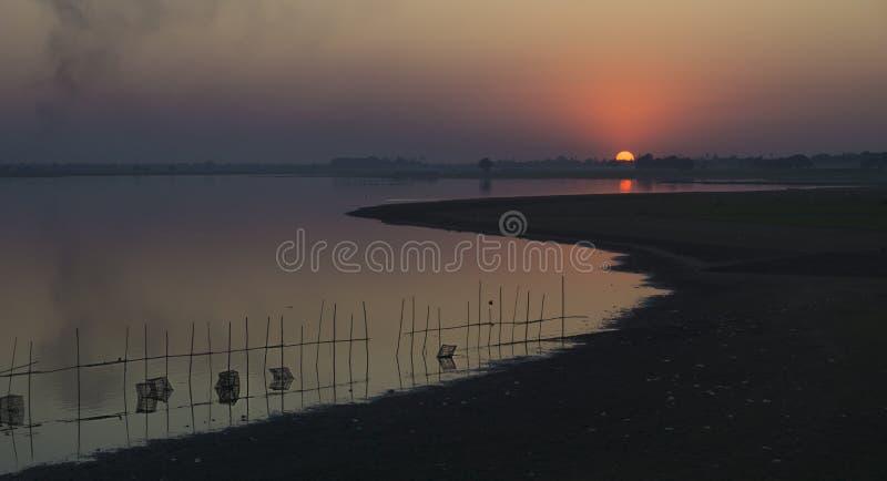 Sunset in Amarapura. Sunset with the landscape of Amarapura, lake, fisher nets, Myanmar stock photo