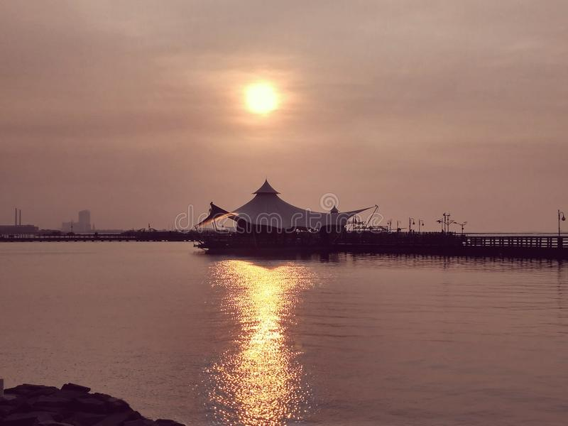 Sunset at Ancol beach royalty free stock photography