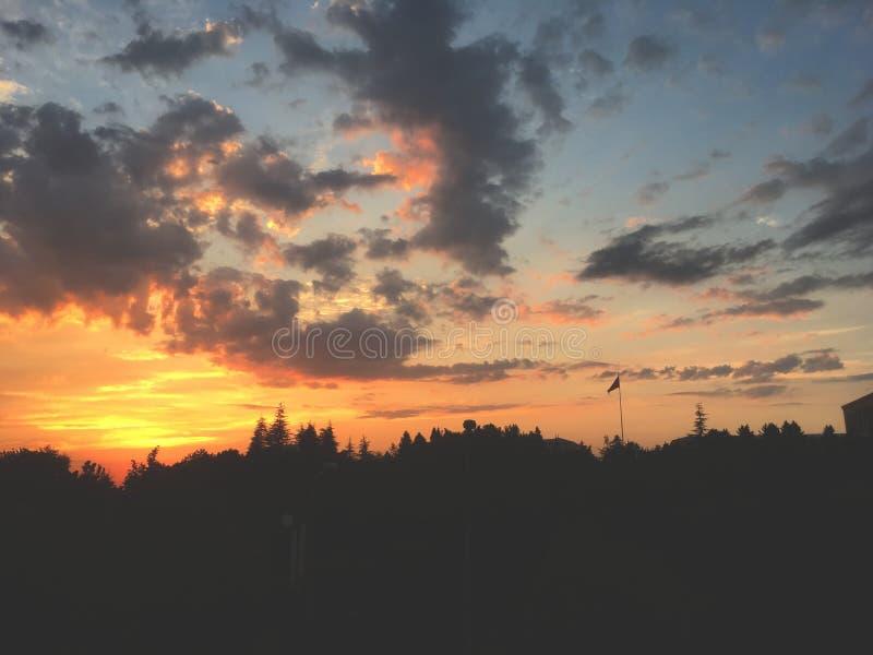 Sunset on Ankara. Flag, clouds, trees royalty free stock photo