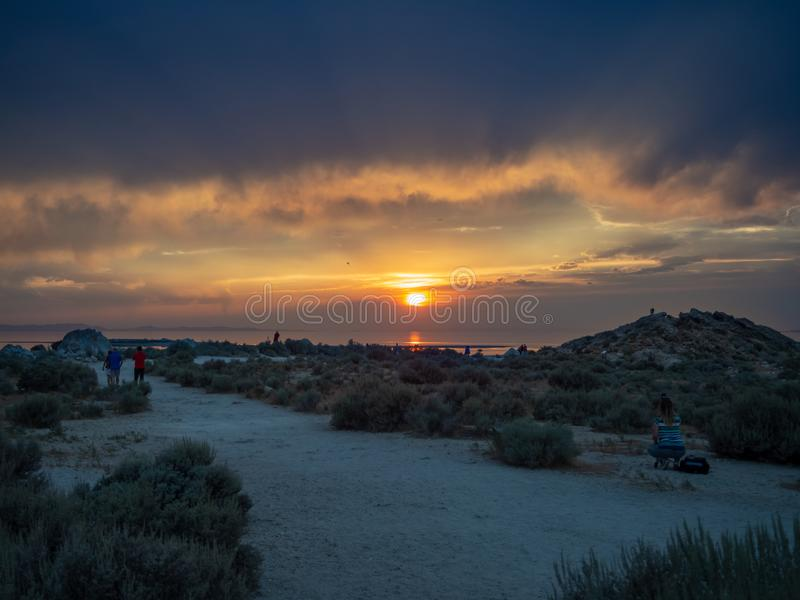 Sunset on the Antelope Island on the great Salt Lake outside the City, colorful orange dusk above a road with buffalos panorama ba royalty free stock photos