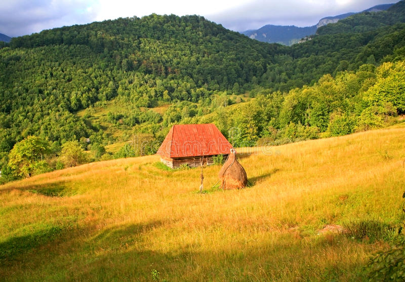 Sunset in Apuseni Mountains. Sunset in Romanian Mountains Apuseni with deep forests and old cottages stock images