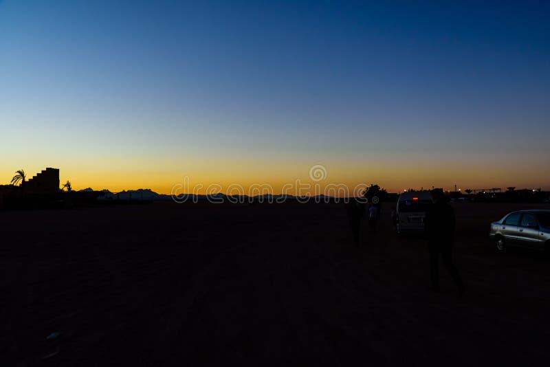Sunset in arabian desert not far from the Hurghada city, Egypt. Hurghada, Egypt - December 10, 2018: Sunset in arabian desert not far from Hurghada city, Egypt royalty free stock image