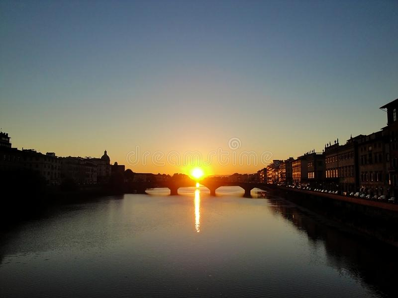 The sunset in Arno river in Florence 0 Italy royalty free stock images