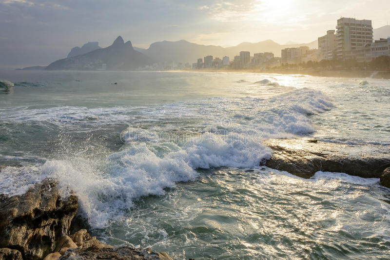 Sunset at Arpoador beach. View of the beautiful sunset at Arpoador beach with Ipanema, Leblon and Two Brothers hill in the background, Rio de Janeiro royalty free stock images