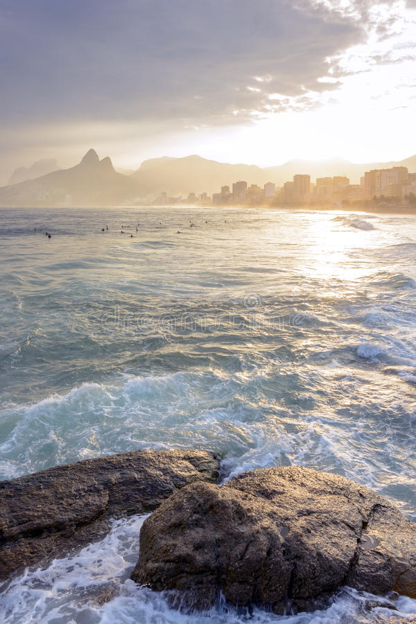 Sunset at Arpoador beach. View of the beautiful sunset at Arpoador beach with Ipanema, Leblon and Two Brothers hill in the background, Rio de Janeiro royalty free stock photo